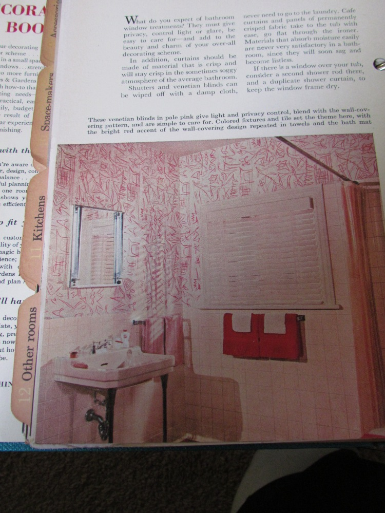 This pink mess looks to be a bathroom. Whoever lived here LOVED boomerang pattern.