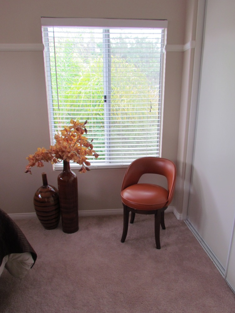 Do the flowers and pottery have to go? Is the chair too orange? Something about it irritates me.