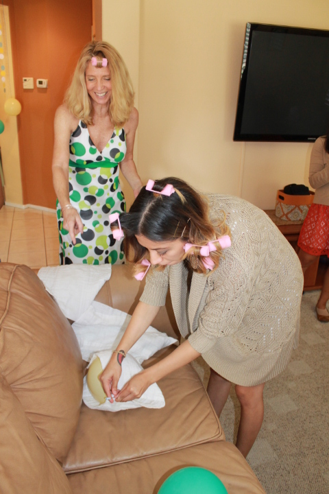 That's my cutey patootie mom in the background, and my little sis-in-law pinning a diaper on a balloon.